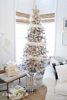 Christmas decor doesn't always have to be red and green, sparkly metallics mixed with neutrals are a great way to use what you already have at this time of year. A flocked Christmas tree decorated with silver and gold and this year's hot trend--copper ornaments, which are available at HomeGoods--is the perfect way to decorate for the holidays. Sponsored Pin.