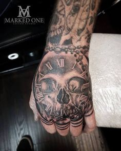 Masculine hand tattoo by Gav Guest. Skull and clock tattoo.