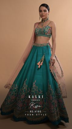 Adorned with Resham, cut dana, zardozi, and pearls embroidered in spring blooms, the teal blue lehenga specializes in cut-work hem as a unique element. With blooming florals and symmetric embroideries, the bridal lehenga is teamed with a sweetheart cut out bustier. The understated flair and the hand-beautified sheer dupatta just looks on point and can be a really offbeat one to try. What say, brides? #TealWatersSeries