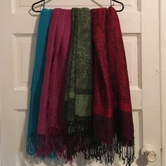 Scarf bundle!! Three pashminas and one wool (teal). All in excellent condition. All are approx 5' long and 2.5' wide. Make an offer on a single scarf if the bundle is not your thing! Accessories Scarves & Wraps
