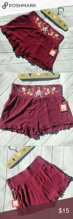 """BOHO High Waisted Gauzy Shorts Burgundy Colored Soft HighWaisted Gauzy Shorts NWT In Prime Condition  Measurements: Waist on flat lay 14.5""""/Length straight down middle 12.5""""/Total Length 13""""  -Soft light weight gauzy feel 100% rayon -Flat Waist band Elastic through out entire back -Front waist band features a rounded top hem -Floral embroidery in lilacs, pinks, white &green -Ruffled bottom hem detailing -Slight pleats in front from waistband  Have a boho style to them Perfect for any summer…"""