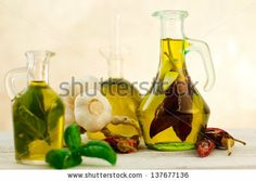oil bottles flavored with herbs and spices - stock photo