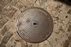 Manholes - Spanje, Cordobas 2014, manhole, manhole cover, stan de haas, kanaldeckel, gullydeckel, asphalt, background, circle, city, cover, detail, drain, grate, gray, hole, iron, metal, old, pavement, road, round, sewage, sewer, sidewalk, steel, street, symbol, underground, urban, water, putdeksel http://www.standehaas.com https://www.facebook.com/pages/Stan-de-Haas-Photography