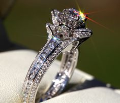 Okay so I'm looking for a ring that looks kind of like this one. My step mom has one like it that is now a necklace . It was her grandmothers. I have always always loved it. One day I would love to have one like it. Gorgeous UNIQUE Flower Rose Diamond Engagement by BeautifulPetra, $4,500.00