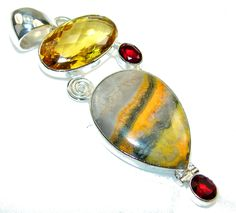 Excellent Yellow Eclipse Stone Sterling Silver Pendant Weight: / Material: Sterling Silver / Main stone: Eclipse Stone / Other stones: Garnet, Sterling Silver Pendants, Garnet, Gemstone Rings, Stones, Fashion Jewelry, Yellow, Shopping, Granada, Rocks