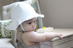 Adorable baby hat with the BEST tutorial for making little straps (in this case: chin straps).  Just finishing a McCalls pattern for similar hat & used this tutorial for the straps.  Perfect!