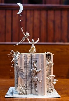 Peter Pan Book Art by anonymous Edinburgh Book Sculptor. I saw so many of these sculptures this summer. They are truly amazing and magical in person.