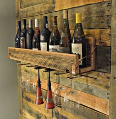 Eight Bottle Reclaimed Barn Wood Wall Mounted Wine Rack With Six Built-In Stemware Hangers $200 found at https://www.etsy.com/listing/215937300/eight-bottle-reclaimed-barn-wood-wall?