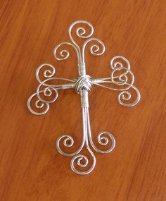 Wire cross.  I would call it the sacred directions in wire.