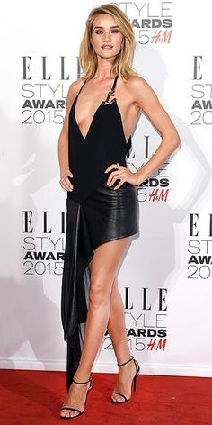 Last Night's Look: Love It or Leave It?   ROSIE HUNTINGTON-WHITELEY    in a Anthony Vaccarello dress with a deep, embellished neckline and asymmetrical hem, plus strappy Jimmy Choo sandals at the 2015 Elle Style Awards in London.