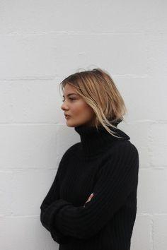 Cozy cute. Black turtleneck, oversized sweater