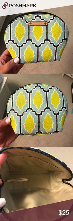 Kate Spade makeup bag Turquoise and lime green printed Kate Spade makeup bag! Only used for one trip. Great condition - a few tiny markings on inside. kate spade Accessories