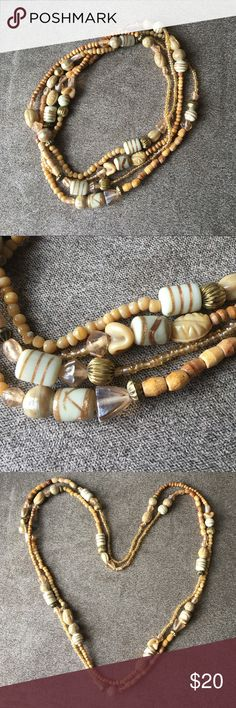 Boho Beaded Necklace Gorgeous boho wooden beaded necklace. Very long- great for layering. Brand new Jewelry Necklaces