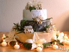 Tiered cheese wheels instead of a wedding cake? In addition to a wedding cake? I think I could totally deal with the second one, especially if that top thicker tier is brie.