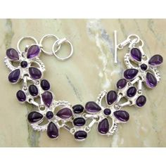 Shop at sterlingsilverjewelry.tv find a unique and handmade 40.60ctw Genuine Amethyst & Solid .925 Sterling Silver Bracelet (SJHB0014ACAB-SS), an online shop for best Gemstones Silver Jewelry at cheapest wholesale price. #braceletdesigns #handmadebracelets  #silvercharmbracelet #braceletsilver #silverbraceletsforwomen #personalizedbracelets Buy Now: https://goo.gl/m5J9BW