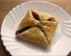 German plunder pastry filled with vanilla pudding and cherries