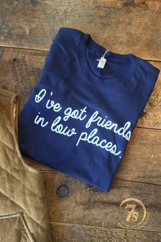 "- ""I've got friends in low places"" graphic t-shirt - Classic Garth Brooks lyrics - White graphics on navy shirt - Great felling soft fit - Adult unisex size t-shirt - Fits true to size - Shown styled Country Girl Style, Country Girls, My Style, Friends In Low Places, Western Wear, Western Chic, Summer Shirts, The Ranch, Graphic Shirts"