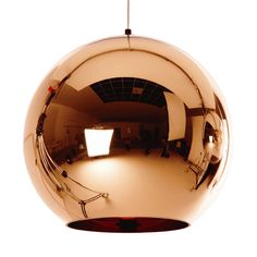 Copper lamp Tom Dixon. I don't know if it looks good with a beige sofa