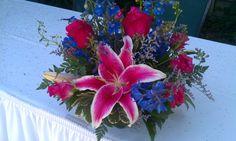 fuschia and royal blue flower arrangements for thsi wedding at Turlock Golf and Country Club, Turlock, CA