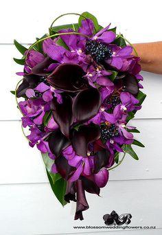 Purple tropical wedding theme | bridal bouquet front purple callas tulips orchids berries and vines ...