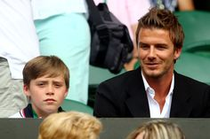 Football player David Beckham and son Brooklyn wait for the Semi final match to start between Andy Murray of Great Britain and Rafael Nadal of Spain on Day Eleven of the Wimbledon Lawn Tennis Championships at the All England Lawn Tennis and Croquet Club on July 2, 2010 in London, England.