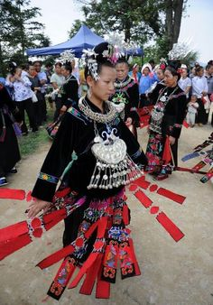People of the Miao ethnic group dance during the Chixin Festival, or New Grain Tasting Festival, in Leishan, southwest China's Guizhou Province, Aug. 1, 2012. Villagers of the Miao ethnic group used to offer sacrifice to their ancestors, and taste new grain with local Lusheng dance and folk songs at the festival.