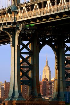 View of the Empire State Building through the tower of the Manhattan Bridge
