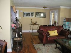ranch style home foyer after renovation; wood flooring; updated foyer; Benjamin Moore desert tan wall color
