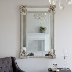 Rococo Vintage Mirror This large, carved plaster mirror is painted in taupe then authentically distressed, and finished with 'antiqued' mirror glass.