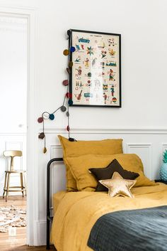 Vintage style kids room. Love the star-shaped metallic pillows.
