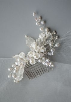 Delicate Tulip Porcelain Flowers & Pearls Bridal Headpiece, Handmade Hair Comb. Spring is in the air, this handmade bridal headpiece features porcelain tulip delicately laid on the comb, emulating flowers slowly budding out from the branches made of high luster natural pearls and wire meshes. This wedding hair comb brings the flowers to live. The shape and arrangement perfectly adorns a range of bridal hairstyles, as well as prom and bridal jewelry. $42