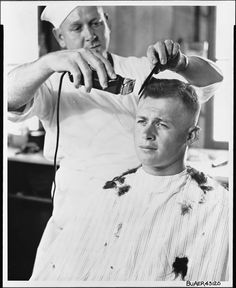 """Recruit Fred Roberts from Greenville, Tennessee, received his first """"G.I."""" haircut in this World War II-era photograph, dated September 28, 1943. Roberts enlisted in the Navy's Seabees."""