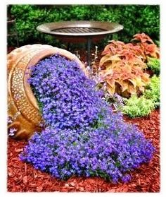 Spilling flowers  100 Container Garden Ideas For Arkansas, Texas, Tennessee and The South, Part 3 Jonesboro | Memphis | South Lawn Care Landscape Jonesboro Garden Flowers Container Gardens Best Flowers For Container Gardens BadAsFlowers Arkansas Garden Annuals