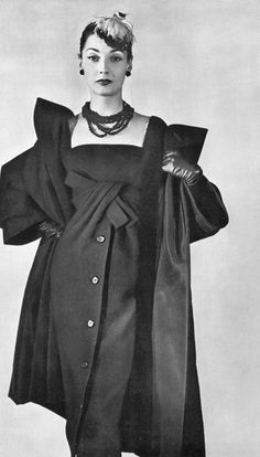 Renée in narrow black wool cocktail dress with voluminous matching coat by Christian Dior, photo by Georges Saad, 1956