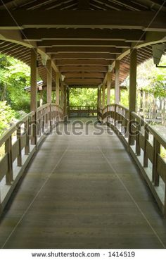a gracefully curved Japanese wooden bridge - stock photo