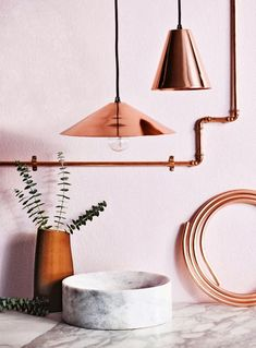 I love the mix of materials and the pink hues. I also love how the pipe on the wall guides your eye to look at everything.  Copper and White Marble