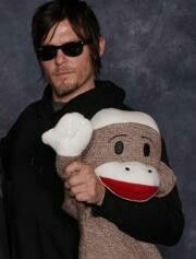 NormanReedus with a  SockMonkey-I knew there was something I liked about him