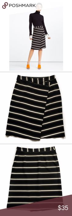 Zara faux wrap skirt Faux wrap skirt in a classic stripe pattern. The asymmetrical fold over button faux wrap gives this skirt a modern twist! Poly/elastane blend has stretch so it's super comfortable. Zara Skirts A-Line or Full