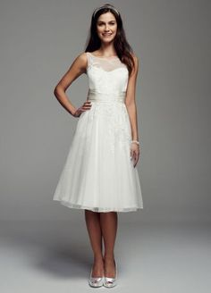 Simply yet stylish, this beaded lace short gown was beautiful crafted for the perfect look!  Sleeveless bodice features delicate dot illusion neckline.  Ruched sash at waist creates a flattering silhouette.  Stunning beaded lace embellishment adds sparkle.  Available online in Ivory. Sizes 0-14.  Fully lined. Back zip. Imported polyester. Dry clean. To preserve your wedding dreams, try our Wedding Gown Preservation Kit.