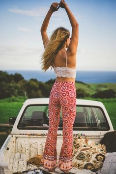 Nice look. Boho, hippie style. White lace bustier top and colorful bell-bottoms pant.