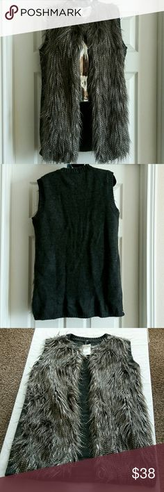 H&M faux Fur Sleeve Sweater Vest New with tags H&M sleeveless faux fur vest. The front shell is imitation fur. 42% polyester, 36% modacrylic, 22% acrylic. Back of sweater. 100% acrylic H&M Jackets & Coats Vests