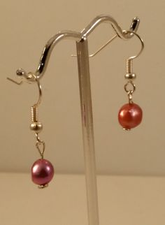 Red and pink natural pearl earrings on a dangle drop hook. by ARPJewellery on Etsy