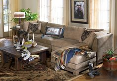 Nice neutral, warm color of buttery soft leather. Looks great with the coffee table. Relaxed and welcoming.