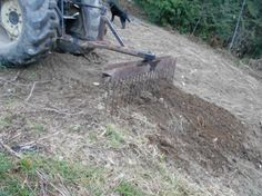 """Root and Rock Rake by Eagle_view -- Homemade root and rock rake fabricated from steel tubing, a 73"""" I-beam, and 10"""" lengths of rebar. http://www.homemadetools.net/homemade-root-and-rock-rake"""