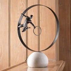 Capturing the energy of movement, the Global Views Circle in Circle Man Sculpture features a realistic acrobat dangling from a circle of metal,. Golden Globe Award, Golden Globes, Extreme Makeover Home Edition, Elegant Homes, Elle Decor, Custom Framing, Decorative Accessories, Accent Decor, Modern Contemporary