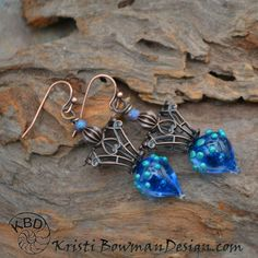Elven Earrings, Blue Lampwork Glass and Brass by KristiBowmanDesign on Etsy