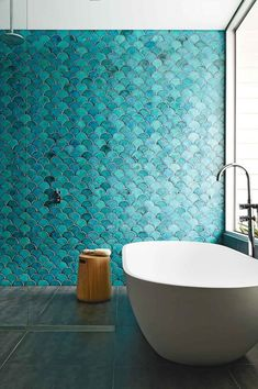 Keep up with tile trends. Fish scale tiles are a great way to update your kitchen or bathroom. Replace your subway tile with fish scale tile to stay on trend. For more design ideas and inspiration, go to Domino. Bad Inspiration, Bathroom Inspiration, Interior Inspiration, Creative Inspiration, Interior Ideas, Blue Green Bathrooms, Turquoise Bathroom, Colorful Bathroom, Bathroom Green