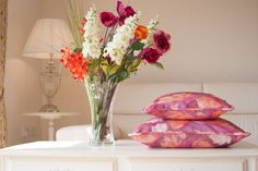 Lotus Blooms cushions in parma violet and fuchsia.    www.foxandlark.co.uk