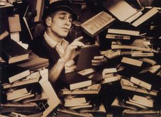 The walls of books around him, dense with the past, formed a kind of insulation against the present world and its disasters.~ Ross MacDonald