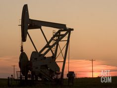 Oil Drilling Pump Silhouetted Against the Sunset in North Dakota Photographic Print by Phil Schermeister at Art.com